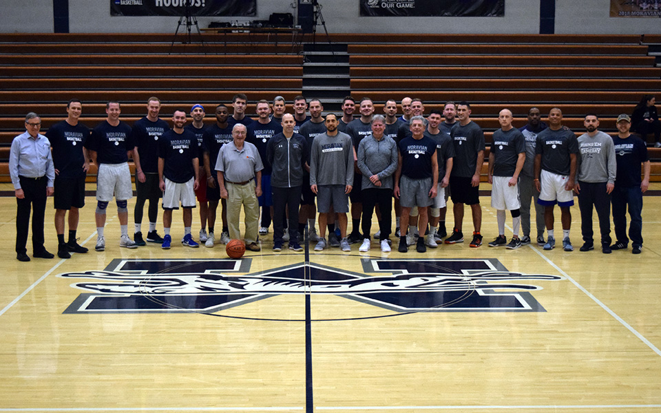 The former players, former coaches and current coaching staff before the 2019 Men's Basketball Alumni Game in Johnston Hall.