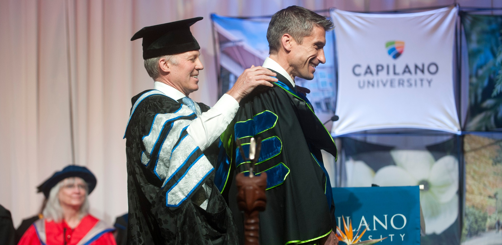 Rick Celebrini receives his honourary Doctor of Letters from CapU President Paul Dangerfield in June 2017. Photo Tae Hoon Kim / Capilano University