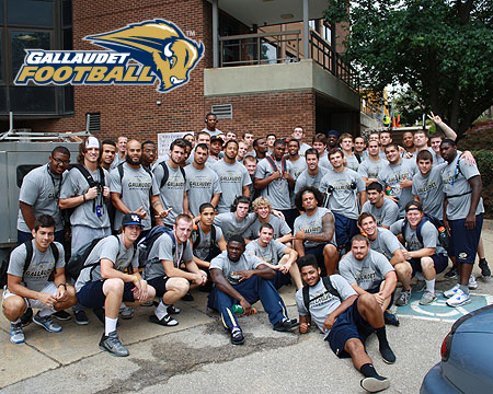 Bison football players volunteer to move-in new students