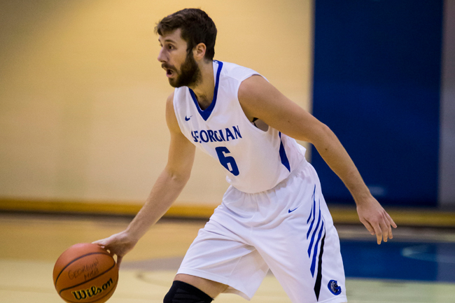 MEN'S BASKETBALL PULL OUT BIG ROAD WIN OVER KNIGHTS