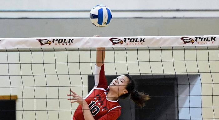 Yue Wue makes one of her 14 kills against Central Florida. (Photo by Tom Hagerty, Polk State.)