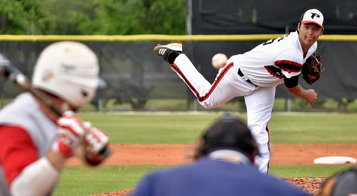 Zak Spivy delivers a pitch in the first inning. He earned his fourth victory of the season, allowing no hits and no runs in three innings. (Photo by Tom Hagerty, Polk State.)