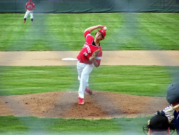 Jeff Davis delivers a pitch against Adrian College. The sophomore picked up the win in the second game with his two scoreless innings in relief. Photo courtesy of Owens Sports Information