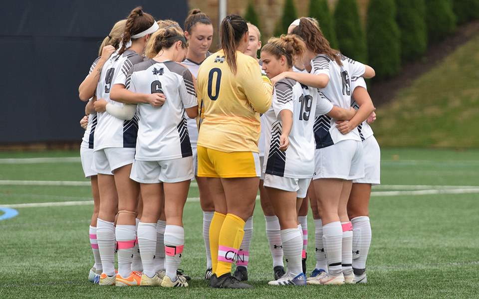 The Greyhounds huddle before the start of a Landmark Conference contest versus The University of Scranton on John Makuvek Field during the 2018 season.