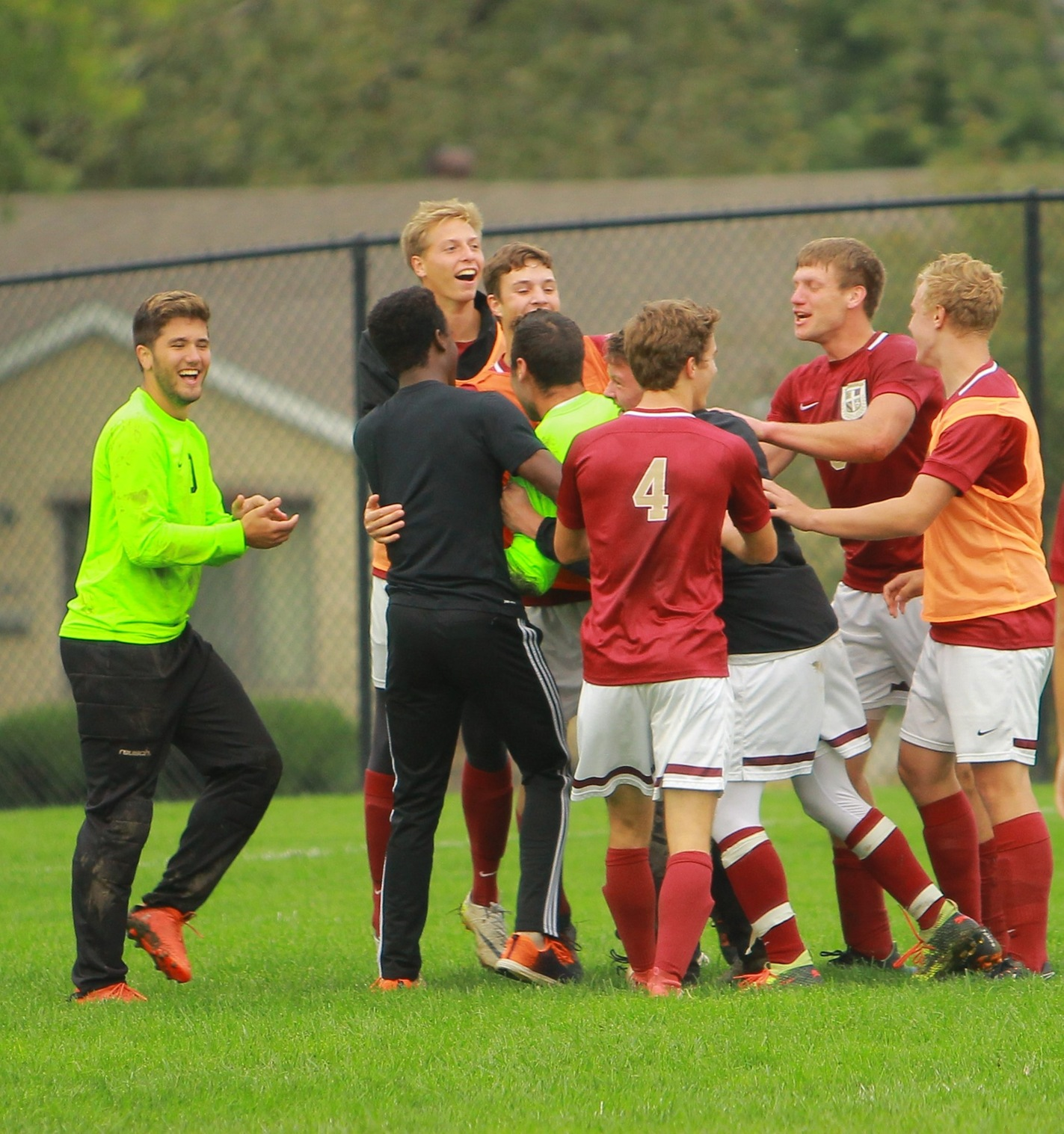 Eagles players mob goalkeeper Daniel Moore following an incredible penalty kick save, ending the game in a 0-0 tie against #10 Emmaus.