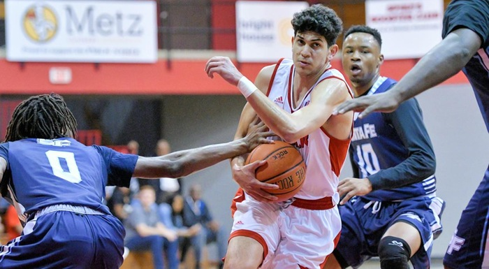 Bryan Polanco drives to the hoop against Santa Fe. He led the Eagles with 18 points in a 60-56 win. (Photo by Tom Hagerty, Polk State.)