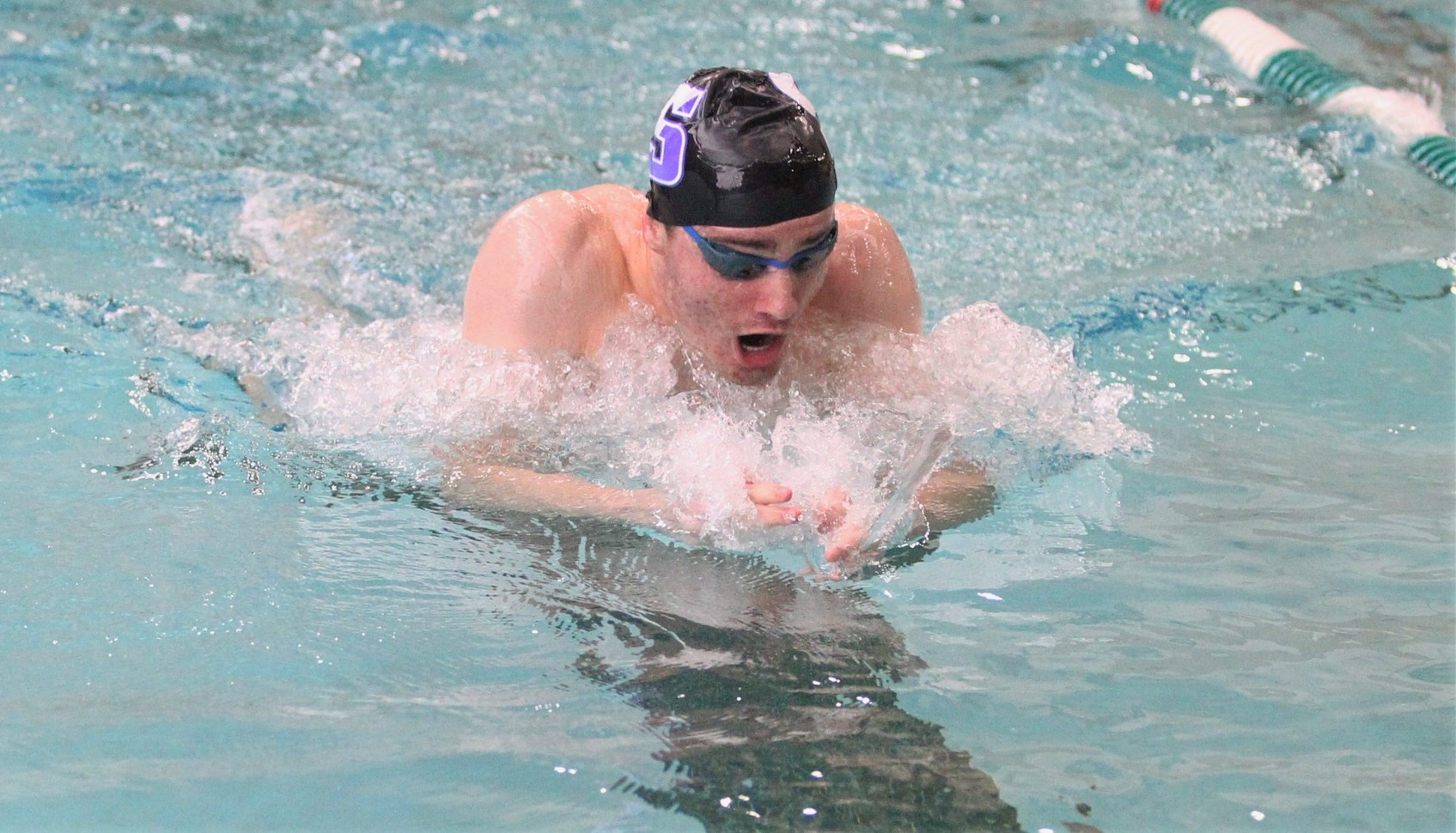 Junior Jack Donnelly won a Landmark Conference title in the 100-breaststroke on Saturday night in Germantown, Md. © Photo by Timothy R. Dougherty / doubleeaglephotography.com