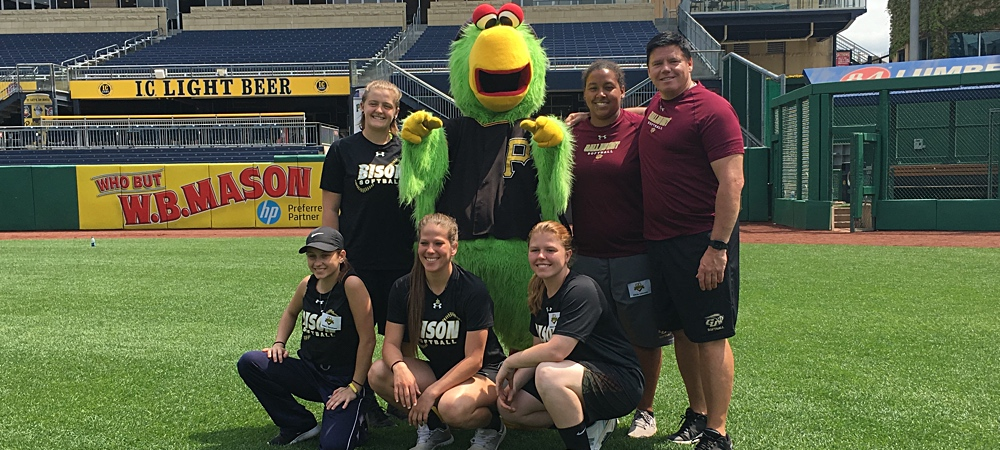 Members of the Gallaudet softball team pose for a group photo with the Pittsburgh Pirates mascot, a parrot.