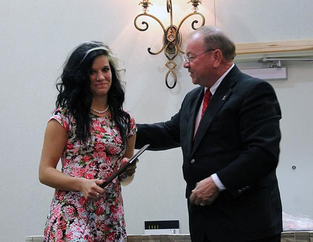 Jessica Grindle accepts her Owens Female Athlete of the Year award from Owens President Dr. Mike Bower at last night's athletic awards banquet. Photo by Nicholas Huenefeld/Owens Sports Information