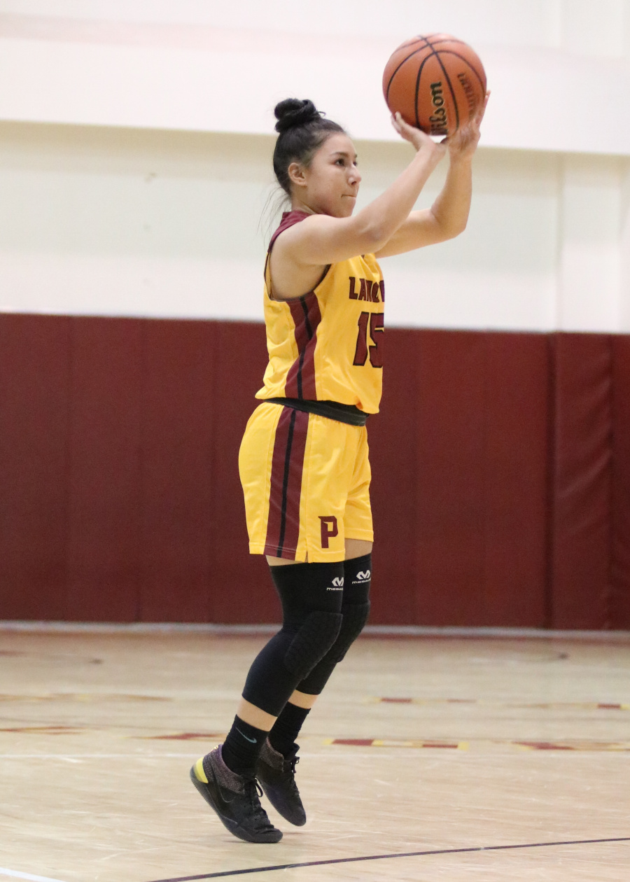 Lancer Melissa Felix fires up one of her five 3-point baskets in PCC's win over Chaffey Wednesday, photo by Richard Quinton.