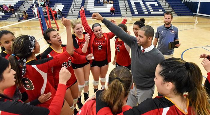 Head Coach German Del Valle and the Eagles celebrate after beating Hillsborough 3-2. (Photo by Tom Hagerty, Polk State.)