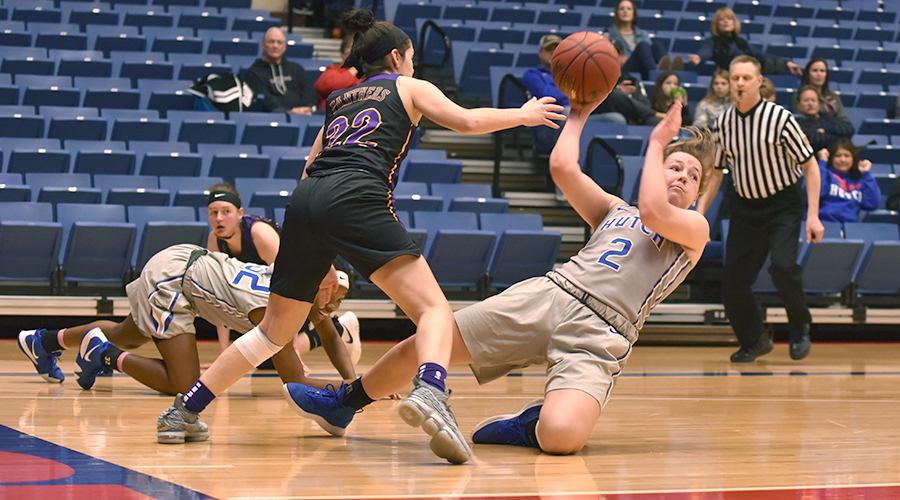 Abby Ogle goes to the floor for a steal in No. 6 Hutchinson's 95-22 rout of Ellsworth in the Polo Bar & Grill/Blue Dragon Holiday Classic on the Sports Arena. (Andrew Carpenter/Blue Dragon Sports Information)