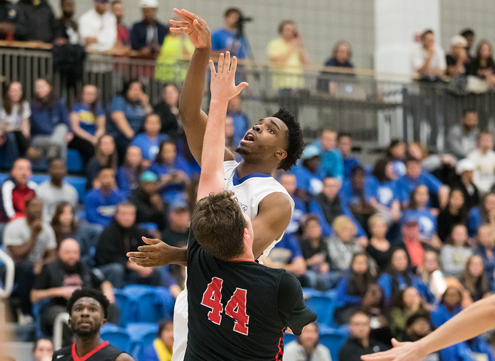Men's Basketball Upends Lasell