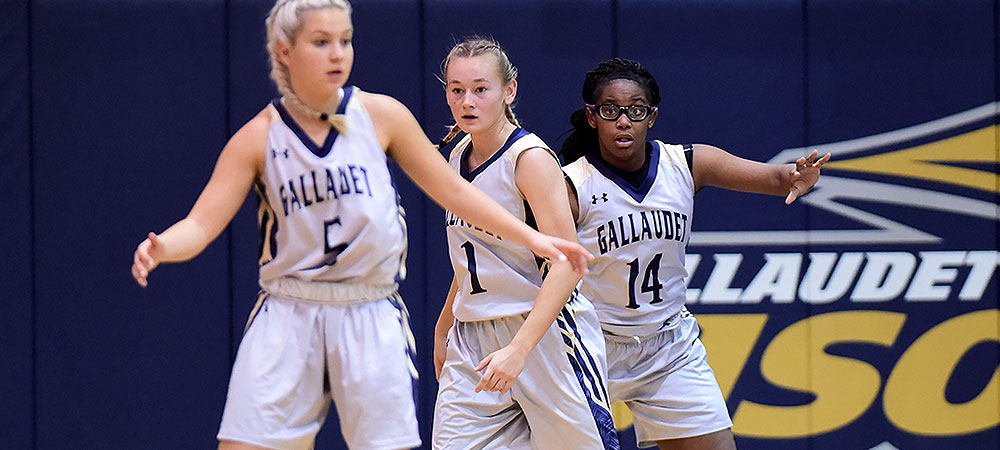 Gallaudet women's basketball defense featuring Emelia Beldon, Sabina Shysh and Shakeedra Hubbard from left to right.
