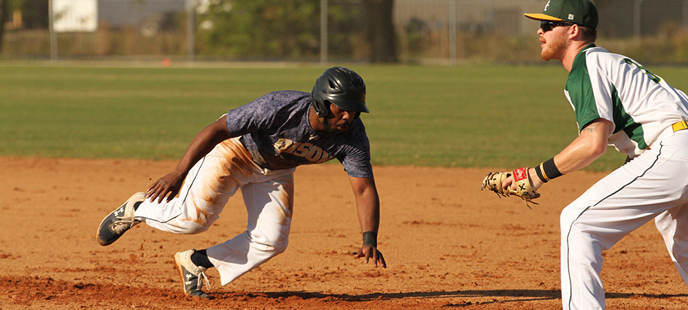 GU baseball player Winston Lane III dives back towards first base as Southern Vermont tries to pick him off in a game in Florida.