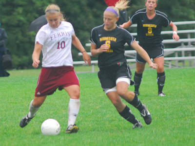 Bri Borgman and the Bulldogs come up just short in  Friday's 2010 season opener.  (Photo by Joe Gorby)