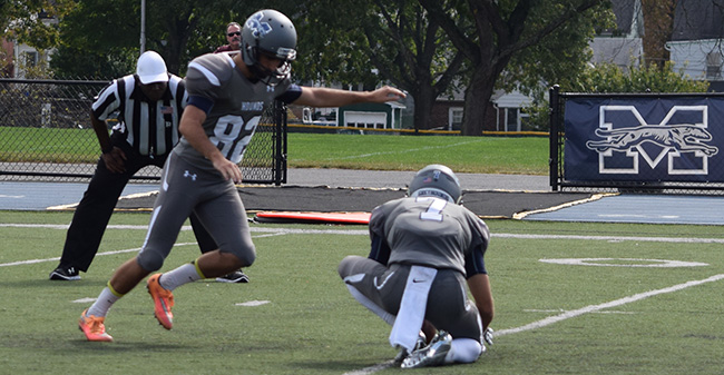 Jon Miller '19 kicks an extra-point against Susquehanna University.