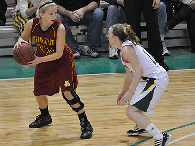 FSU's Sarah DeShone protects the ball in Sunday's game at Northern Michigan (Photo by Rob Bentley)