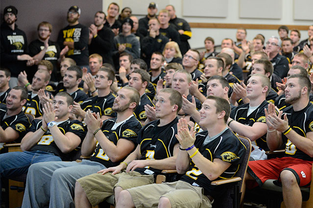 The UW-Oshkosh football team watches the NCAA Selection Show