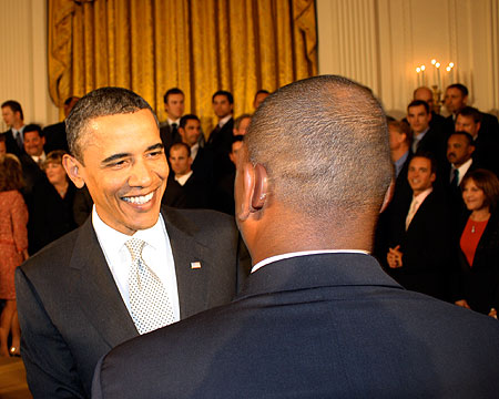 President Obama shakes hands with Coach Pride