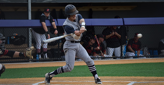 Chase Rogers '19 connects on a single during the Landmark Conference Tournament opener versus The Catholic University of America at Scranton.