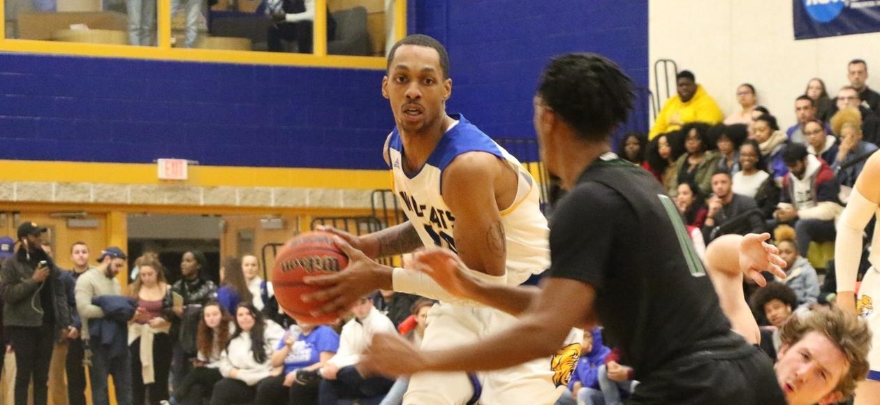 JWU Holds on to Beat Regis 60-56