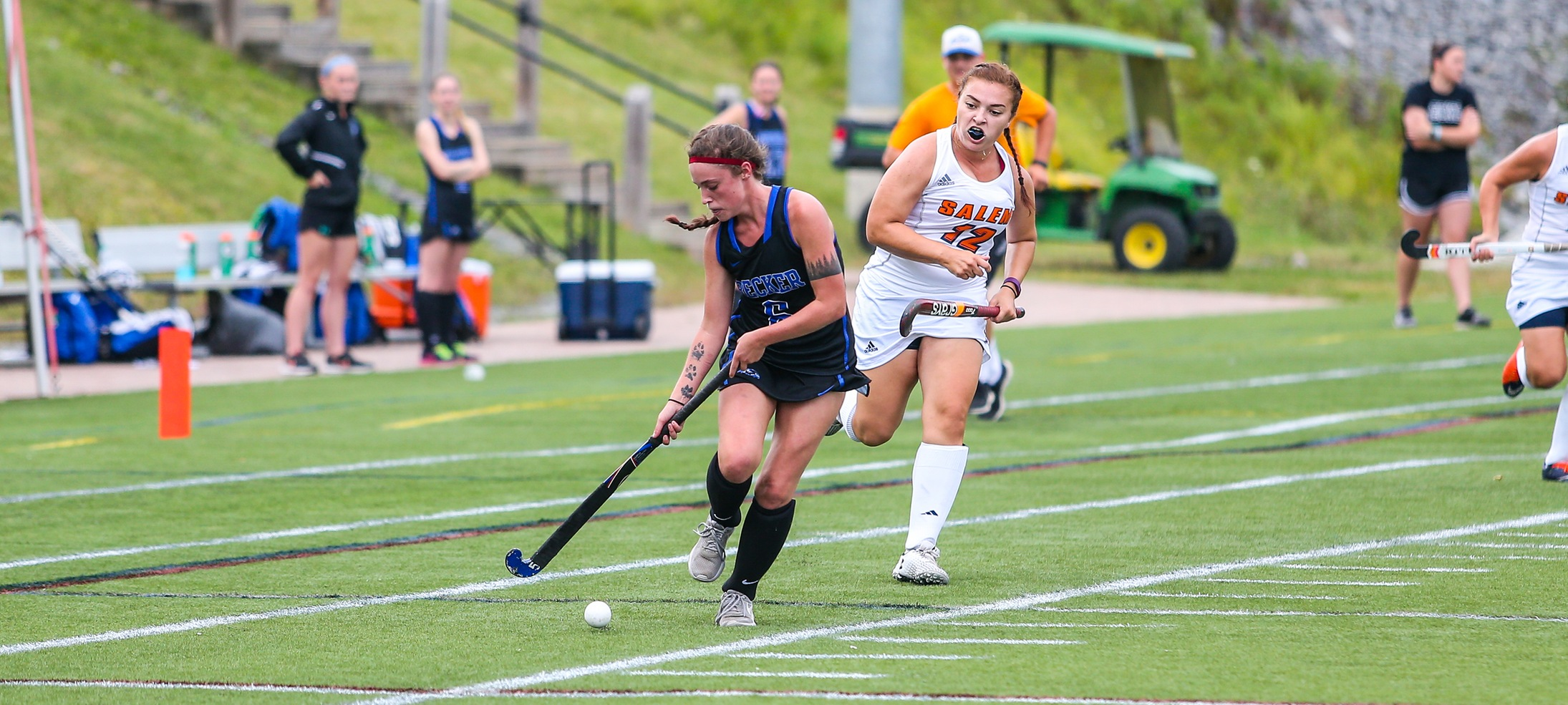 Field hockey's Amy Cooper beating a Salem State defender