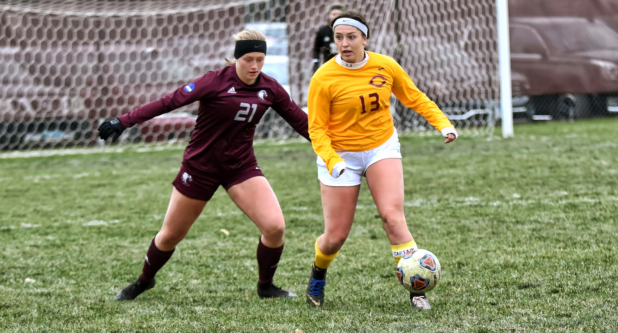 Senior Kalli Baarstad keeps the ball away from an Augsburg defender during the second half of the Cobbers' game with the Auggies. Baarstad led CC with four shots.