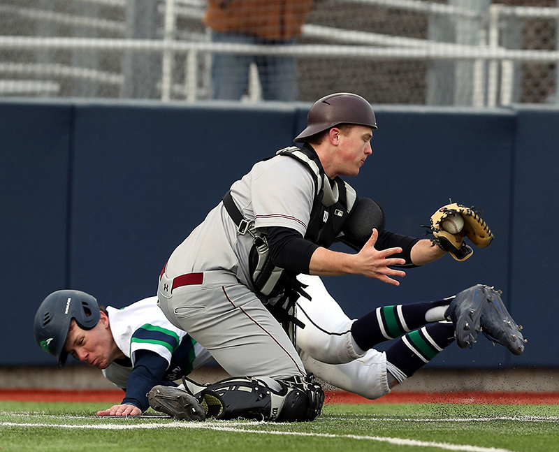 Matt Bald avoids a tag at home plate.