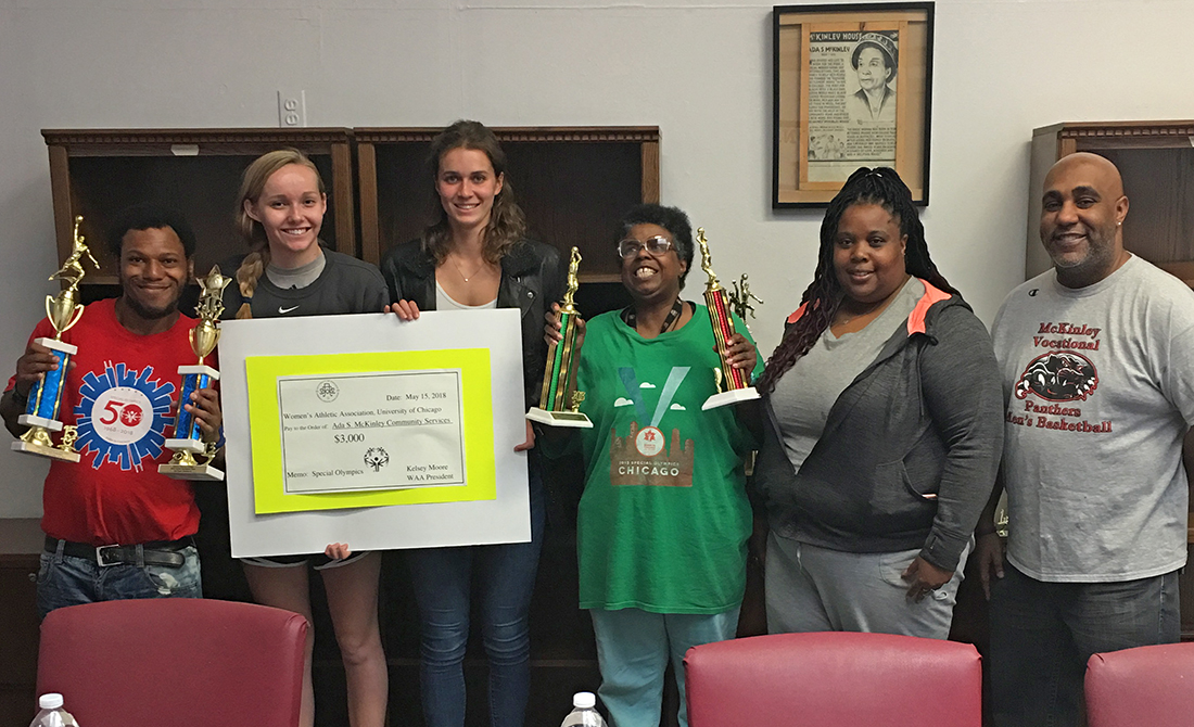 WAA members Miranda Burt and Mary Martin recently delivered a check to Ada S. McKinley Special Olympics team.
