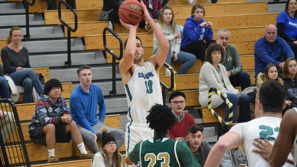 Freshman Mikey Spencer takes a corner three for the Seahawks. (Photo by Logan Marsh)