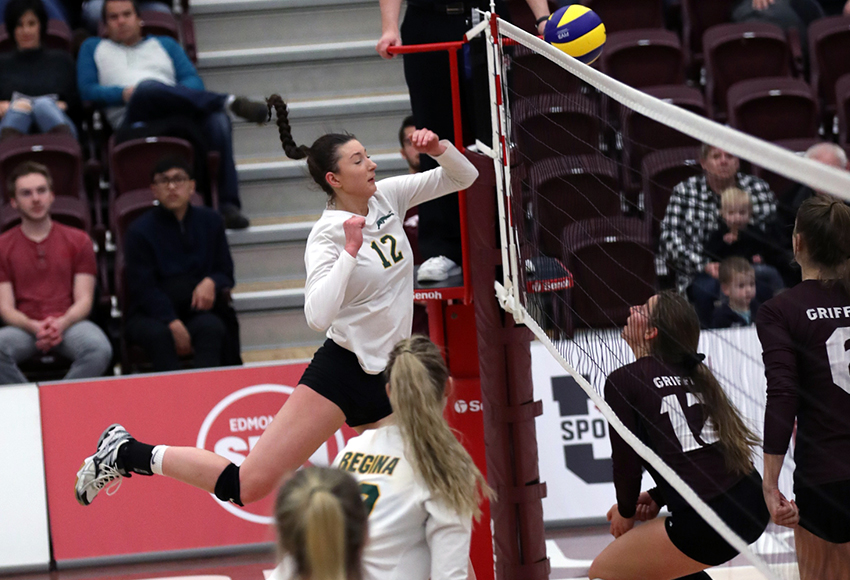 MacEwan's Kylie Schubert waits for a ball delivered over by Regina's Jessica Lerminiaux on Saturday night (Eduardo Perez photo).