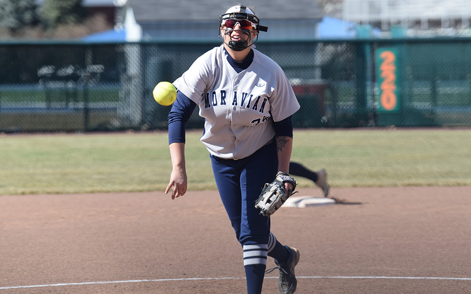 Junior Paige Lesher tossed a pitch towards the plate versus Drew University at Blue & Grey Field.