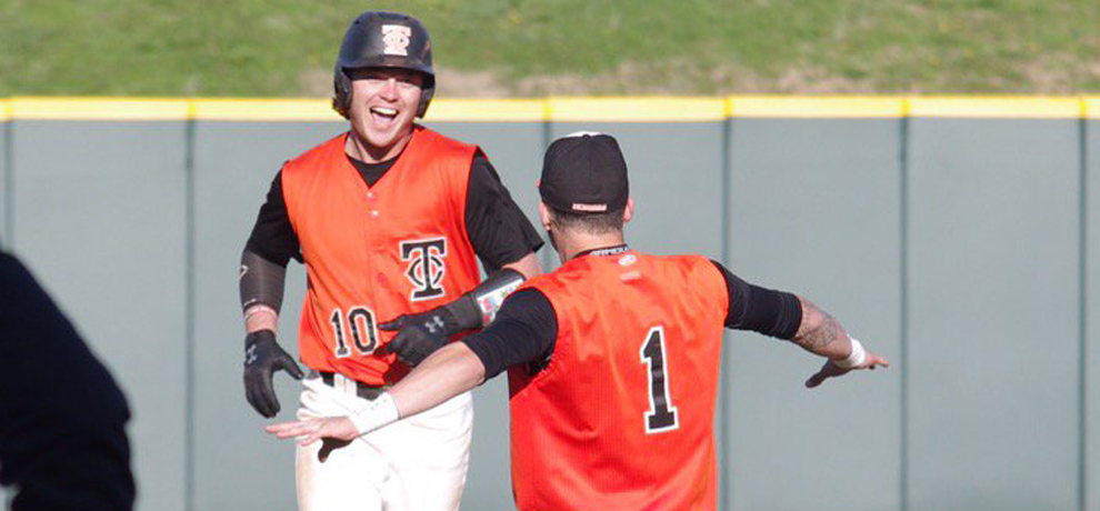 Zack Finchum celebrates his walk-off double in the first game as Tusculum and Winston-Salem split a DH Thursday (photo by Chris Lenker).