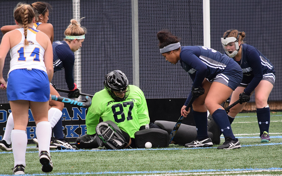 Ashley Kunsman makes a save on a penalty corner versus Goucher College during the 2018 season with Devyn Lapp, Talea Gordon and Emily Duddy ready to clear the ball.