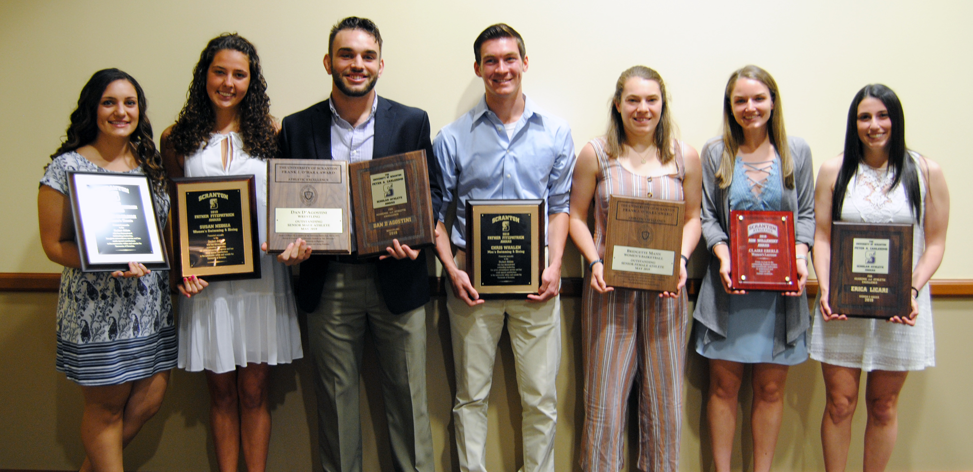 The major award winners from Saturday's 2019 Senior Student-Athlete Brunch (L to R); Elyse Smilnak (women's tennis), Susan Neggia (women's swimming & diving), Dan D'Agostini (wrestling), Chris Whalen (men's swimming & diving), Bridgette Mann (women's basketball), Claire Eberle (women's lacrosse), and Erica Licari (women's soccer).