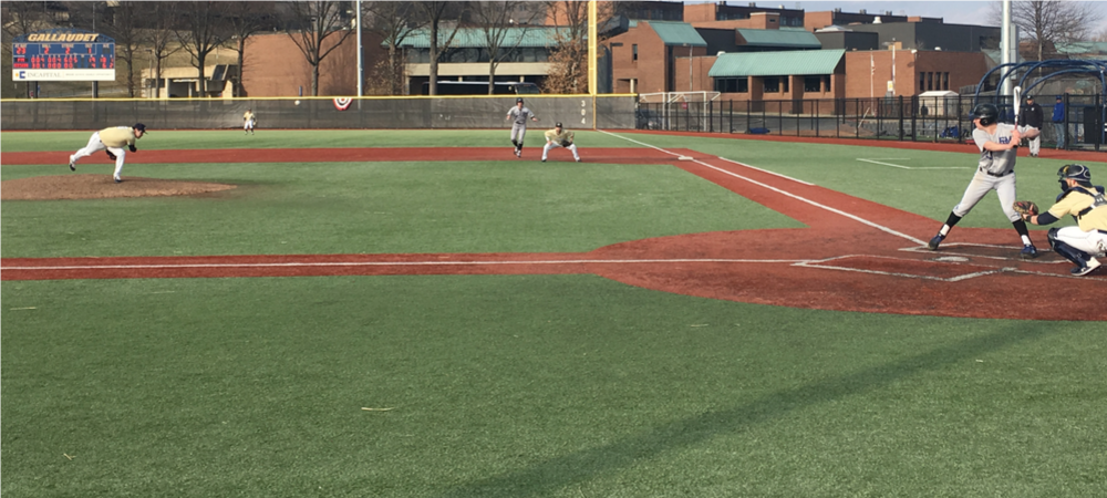Gallaudet baseball pitcher Josh Dugan throws a pitch to a batter at Hoy Field.