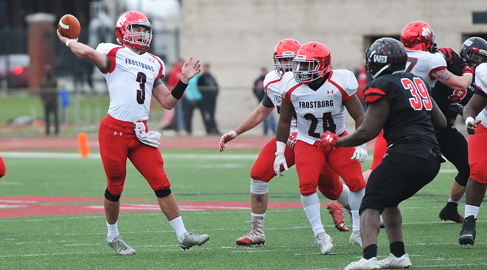 Frostburg State quarterback Connor Cox gets ready to release a pass during the team's second-round playoff game in 2017 at Washington & Jefferson.