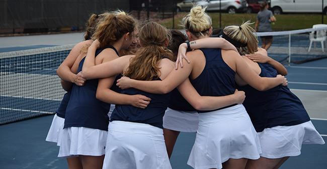 The Greyhounds huddle up before the start of their final fall match versus NCAA Division I Lafayette College.
