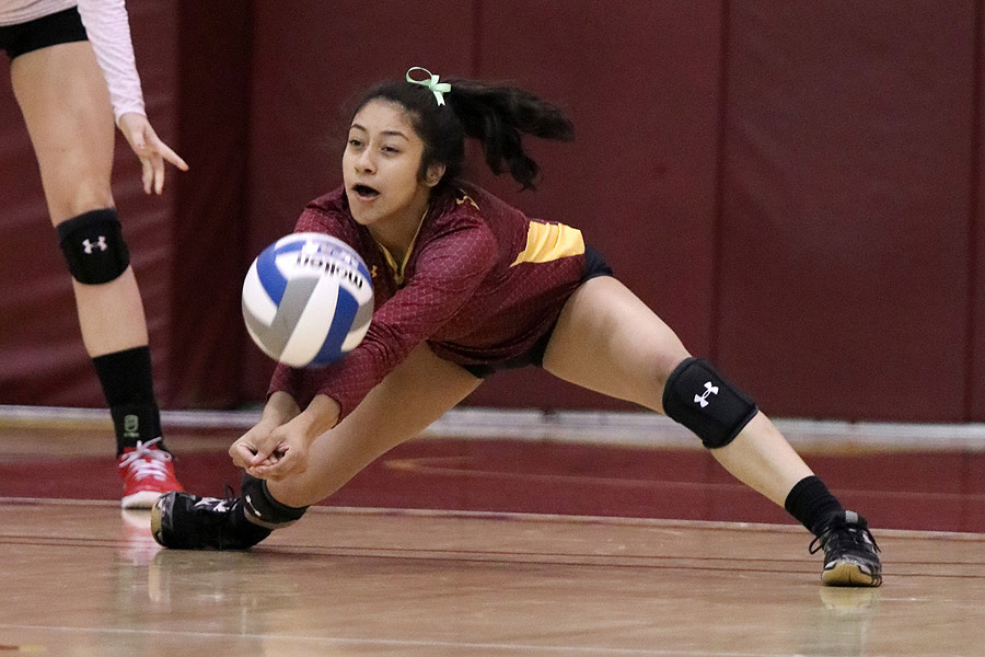 Lancers libero Emily Ramirez gets a dig here during a recent match, photo by Richard Quinton.