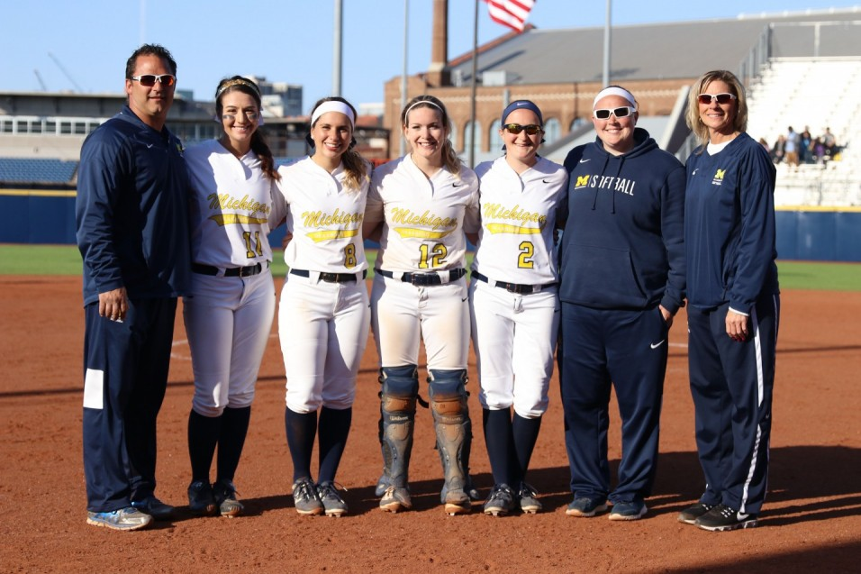 Wolverines split with Cardinals on Senior Day