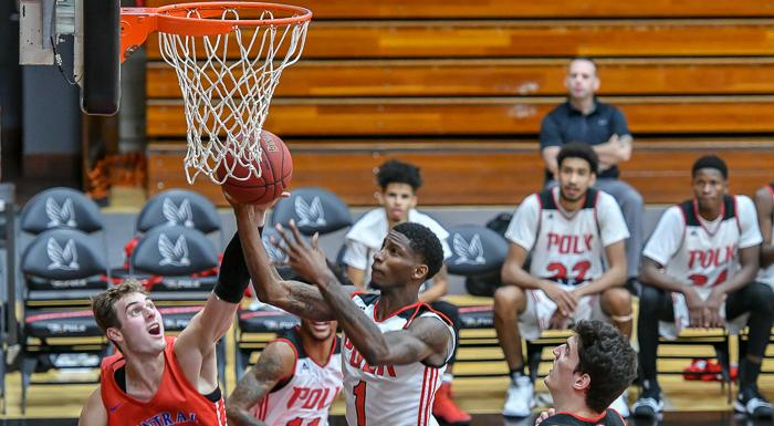 "Tekorian ""TK"" Smith scores two of his 23 points in an 83-81 win over Central Florida.  (Photo by Tom Hagerty, Polk State.)"