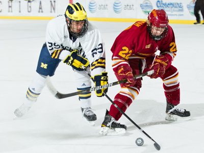 Derek Graham battles for the puck in Saturday's action at Michigan.  (Photo by Scott R. Galvin)