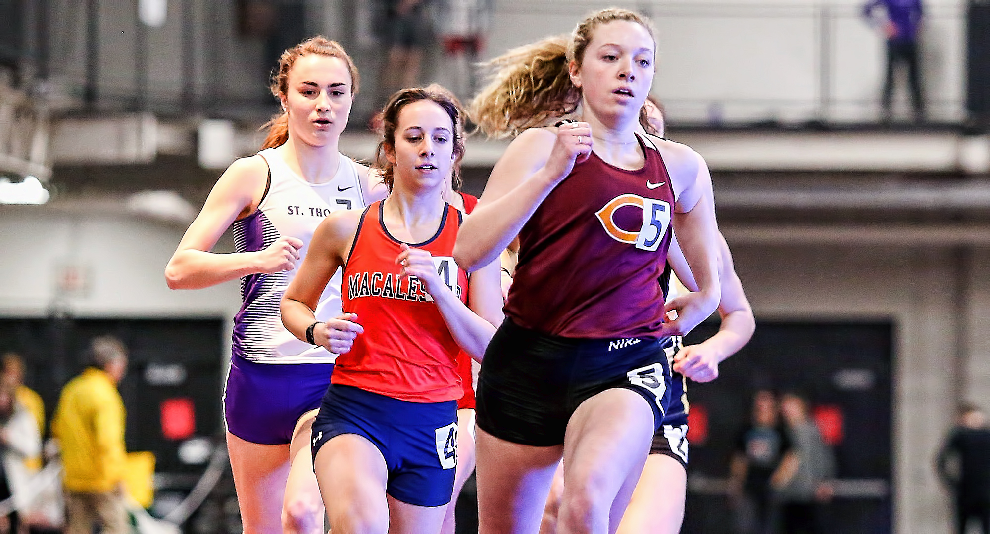 Sophomore Josie Herrmann sprints past a pack of runners during her second-place finish in the 800 meters at the MIAC Indoor Meet. (Photo courtesy of Nathan Lodermeier)
