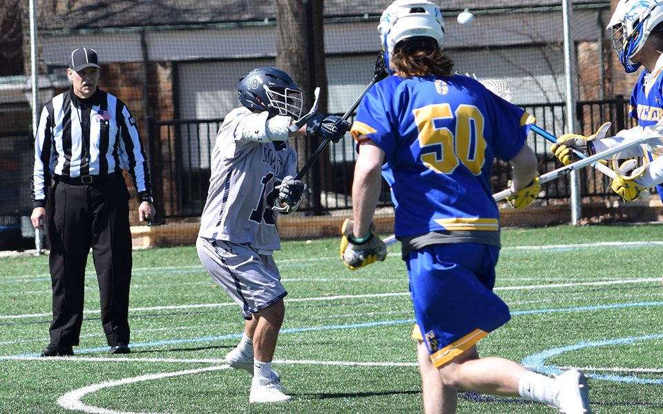 Sophomore Connor Hull fires in a goal versus Goucher College on John Makuvek Field.