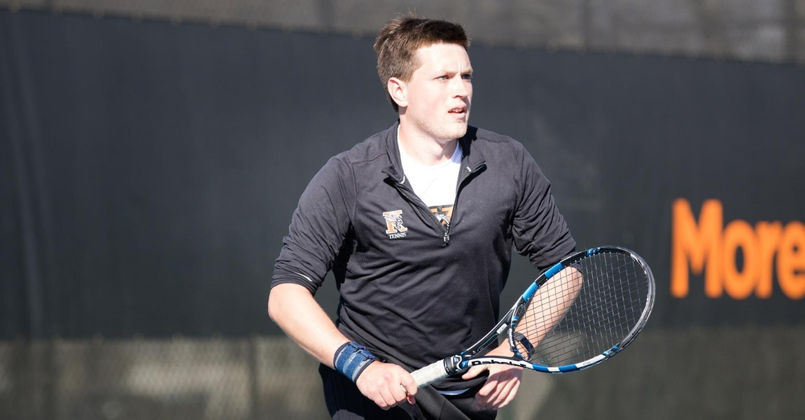 Alex Cadigan playing tennis.