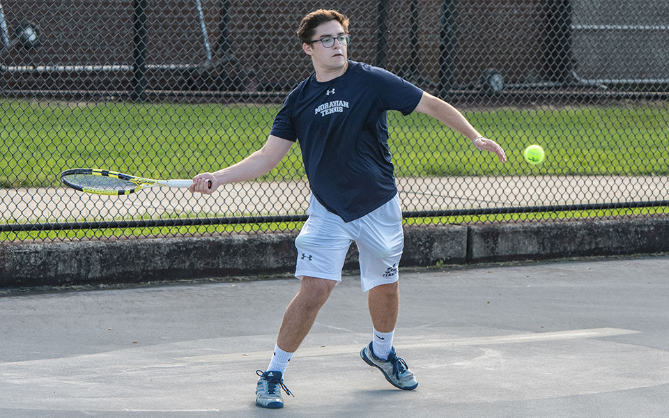 Senior Isaac Schefer returns a shot in doubles action versus FDU-Florham on Hoffman Courts during the fall 2018 season.