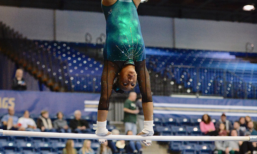 BRENT, JUAREZ WIN EVENTS AS GYMNASTICS SETS SEASON HIGH