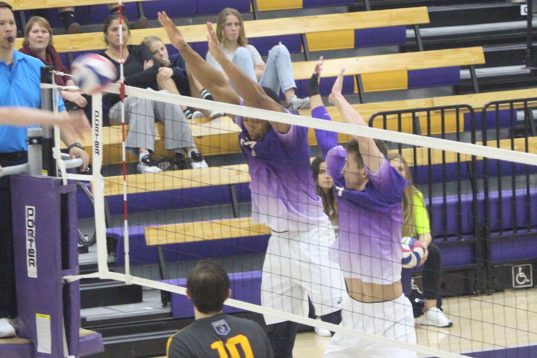 (Left to Right) Dasmen Stewart and Brendan Ward combine for a block.