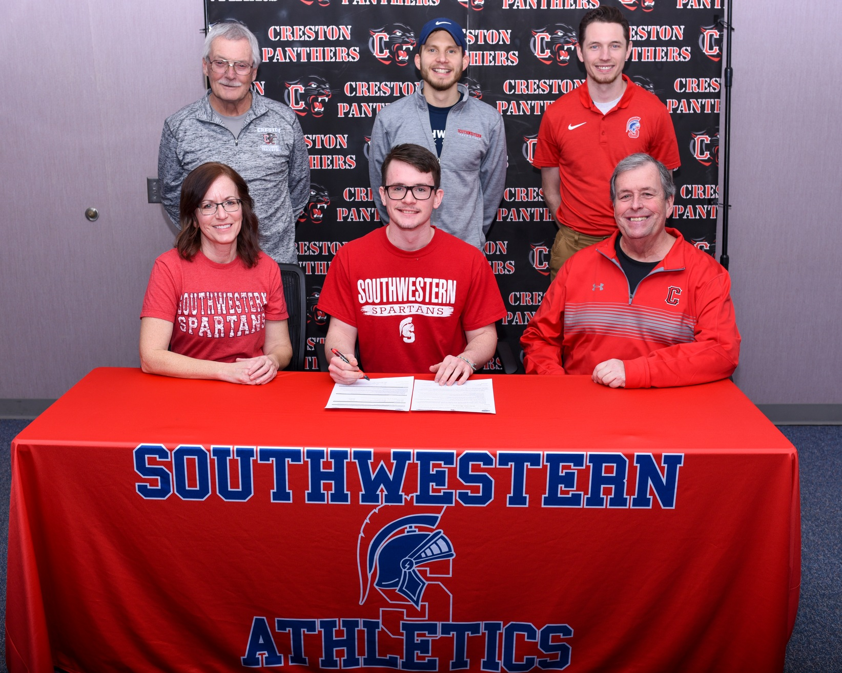 Creston's Jared Moreland signs his National Letter of Intent to run cross country and track and field at Southwestern Community College.